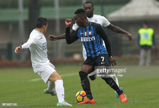 Yann Karamoh of FC Internazionale is challenged during the Serie A Primavera match between FC Internazionale U19 and Novara Calcio U19 at Stadio...