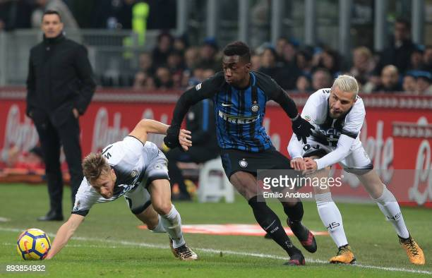 Yann Karamoh of FC Internazionale Milano competes for the ball with Valon Behrami and Silvan Widmer of Udinese Calcio during the Serie A match...