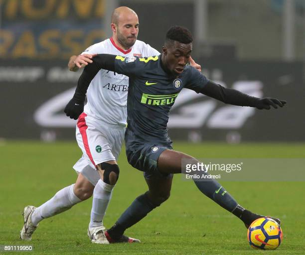 Yann Karamoh of FC Internazionale Milano is challenged by Emanuele Berrettoni of Pordenone Calcio during the TIM Cup match between FC Internazionale...