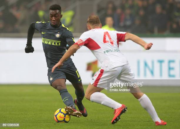Yann Karamoh of FC Internazionale Milano is challenged by Mirko Stefani of Pordenone Calcio during the TIM Cup match between FC Internazionale and...