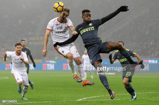 Yann Karamoh of FC Internazionale Milano jumps for the ball against Leonardo Nunzella of Pordenone Calcio during the TIM Cup match between FC...