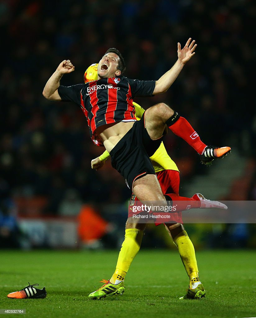 Yann Kermorgant of Bournemouth clashes with Ben Watson of Watford during the Sky Bet Championship match between AFC Bournemouth and Watford City at Goldsands Stadium on January 30, 2015 in Bournemouth, England.
