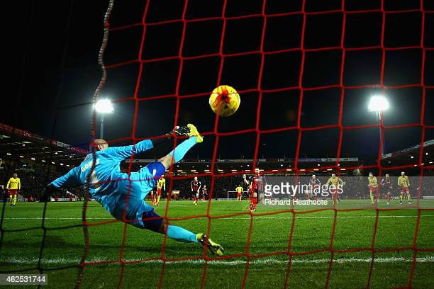 Yann Kermorgant of Bournemouth scores the opening goal from the penalty spot past Heurelho Gomes of Watford during the Sky Bet Championship match...