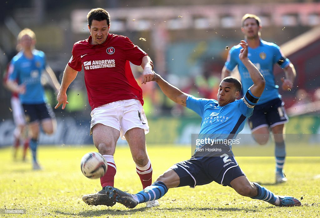 Yann Kermorgant of Charlton is tackled by Lee Peltier of Leeds during the npower Championship match between Charlton Athletic and Leeds United at the Valley on April 06, 2013 in London, England.