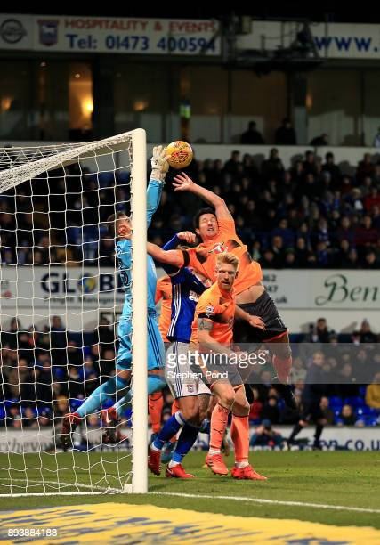 Yann Kermorgant of Reading and Bartosz Bialkowski of Ipswich Town compete for the ball during the Sky Bet Championship match between Ipswich Town and...