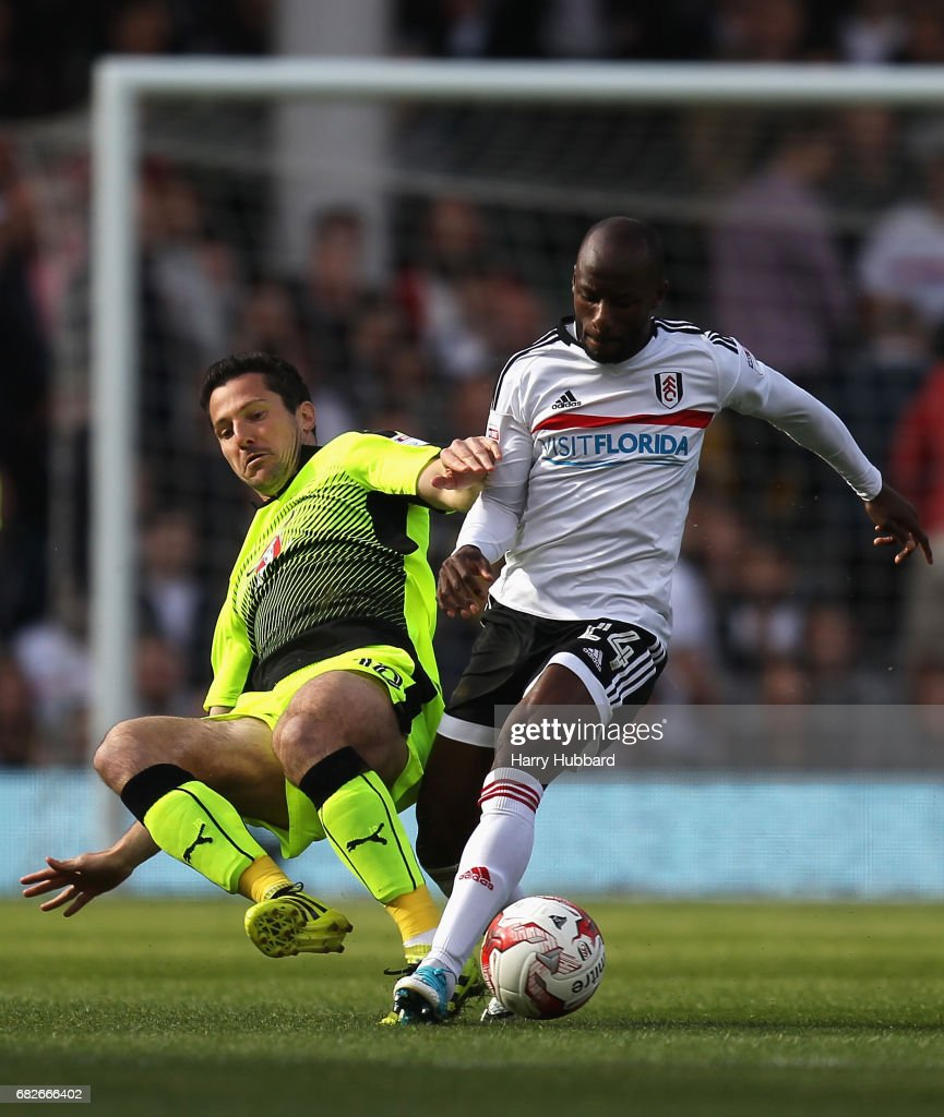 Yann Kermorgant of Reading tackles Sone Aluko of Fulham during the Sky Bet Championship Play off semi final 1st leg match between Fulham and Reading at Craven Cottage on May 13, 2017 in London, England.