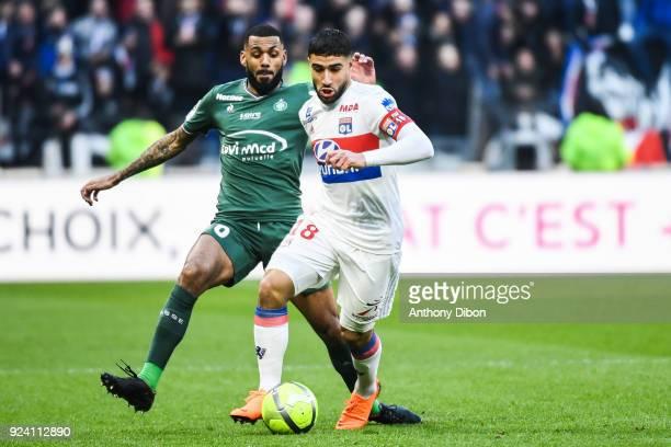 Yann M Villa of Saint Etienne and Nabil Fekir of Lyon during the Ligue 1 match between Olympique Lyonnais and AS SaintEtienne at Parc Olympique on...