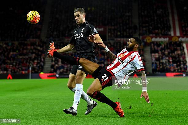 Yann M'Vila of Sunderland battles for the ball with Jordan Henderson of Liverpool during the Barclays Premier League match between Sunderland and...