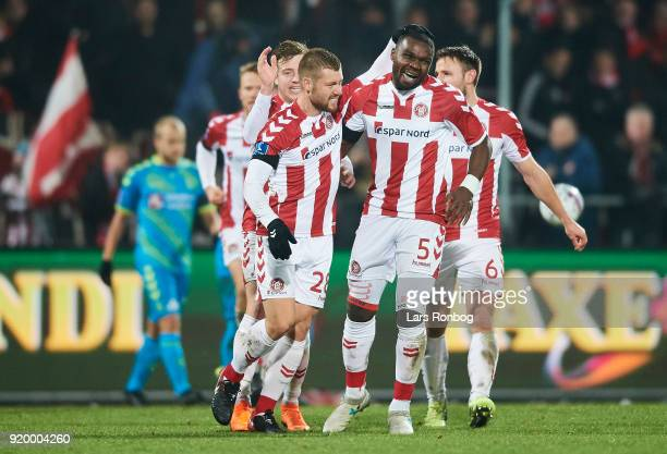 Yann Rolim and Jores Okore of AaB Aalborg celebrate after scoring their first goal during the Danish Alka Superliga match between AaB Aalborg and...