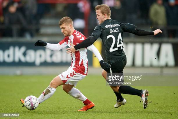 Yann Rolim of AaB Aalborg and Jonas Bager of Randers FC compete for the ball during the Danish Alka Superliga match between AaB Aalborg and Randers...