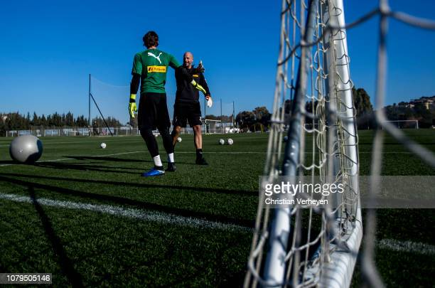 Yann Sommer and Goalkeeper Coach Steffen Krebs of Borussia Moenchengladbach of Borussia Moenchengladbach in action during a training session at...