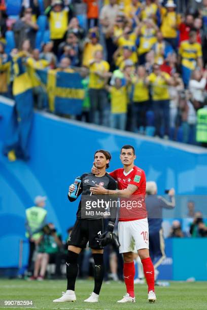Yann Sommer and Granit Xhaka of Switzerland national team comfort each other after their defeat during the 2018 FIFA World Cup Russia Round of 16...