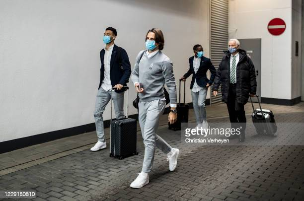Yann Sommer and Ramy Bensebainiof Borussia Moenchengladbach are seen during Borussia Moenchengladbach departs to the Group B - UEFA Champions League...