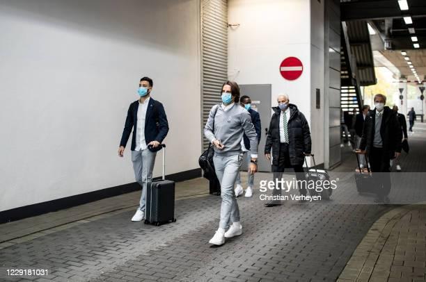 Yann Sommer and Ramy Bensebainiof Borussia Moenchengladbach are seen during Borussia Moenchengladbach departs to the Group B UEFA Champions League...