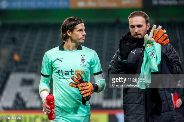 Yann Sommer and Tobias Sippel of Borussia Moenchengladbach are seen after the Bundesliga match between Borussia Moenchengladbach and VfL Wolfsburg at...