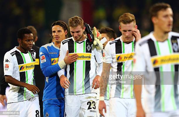 Yann Sommer goalkeeper of Gladbach comforts teammate Christoph Kramer after the Bundesliga match between Borussia Dortmund and Borussia...