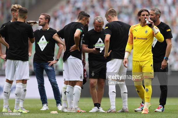 Yann Sommer of Borussia Moenchengladbach has a drink following their victory in the Bundesliga match between Borussia Moenchengladbach and Hertha BSC...