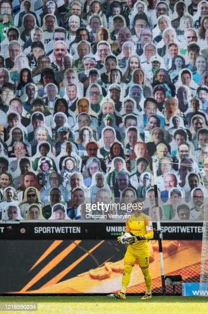 Yann Sommer of Borussia Moenchengladbach in action in front of the cardboards with photos of Moenchengladbach fans displayed on the stands during the...