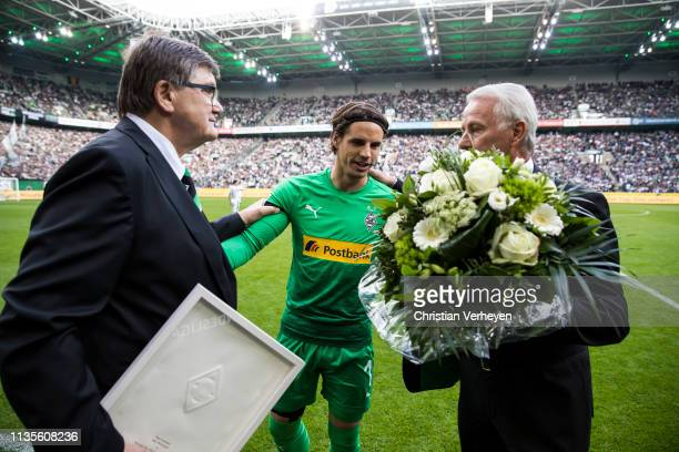 Yann Sommer of Borussia Moenchengladbach is honored by Bureau Member Hans Meyer of Borussia Moenchengladbach and Vice President Rainer Bonhof of...