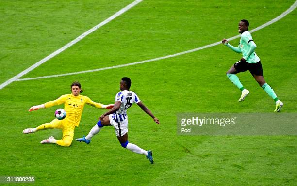 Yann Sommer of Borussia Moenchengladbach is sent off for this challenge on Jhon Cordoba of Hertha Berlin during the Bundesliga match between Hertha...