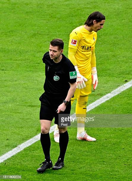 Yann Sommer of Borussia Moenchengladbach walks off after being shown a red card and sent off during the Bundesliga match between Hertha BSC and...