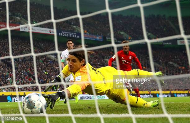 Yann Sommer of Borussia Monchengladbach dives to make a save on the line during the Bundesliga match between Borussia Moenchengladbach and FC Bayern...