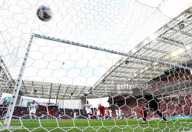 Yann Sommer of Switzerland fails to stop Cristiano Ronaldo of Portugal from scoring his team's first goal from a free kick during the UEFA Nations...