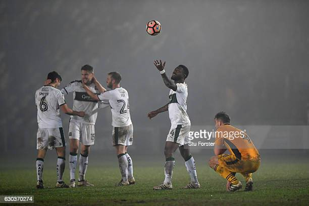 Yann Songo'o and team mates celebrate after winning in extra time during The Emirates FA Cup Second Round Replay between Newport County and Plymouth...