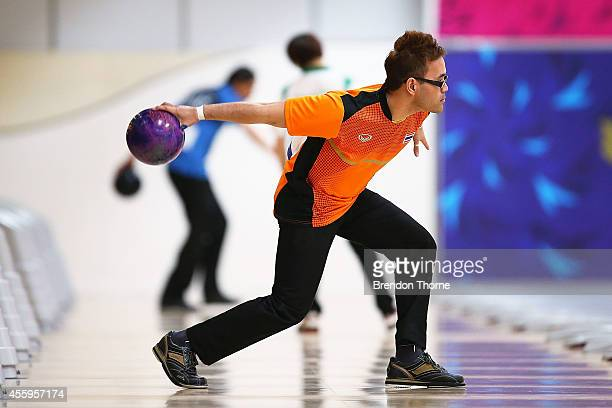 Yannaphon Larp Apharat of Thailand competes in Group B of the Men's Singles Final during day four of the 2014 Asian Games at Anyang Hogye Stadium on...