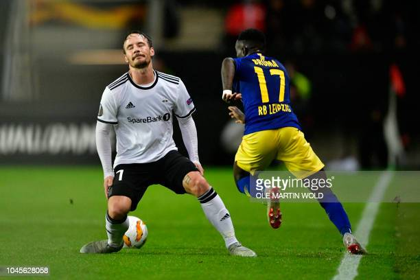 YannErik de Lanlay of Rosenborg and Leipzig's Portuguese forward Bruma vie for the ball during the UEFA Europa League Group B football match...