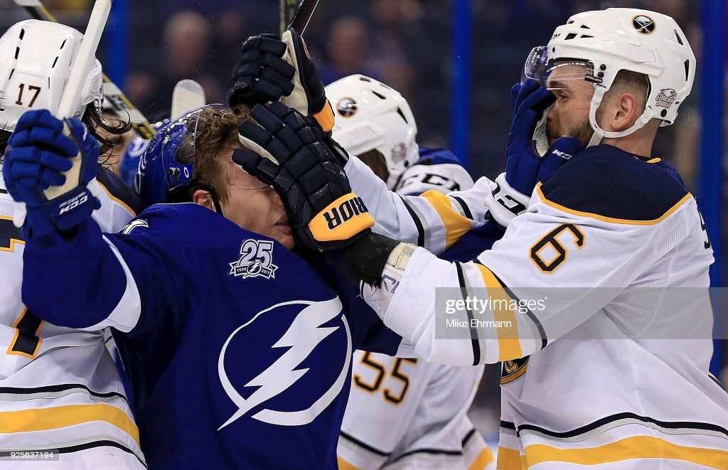 Yanni Gourde #37 of the Tampa Bay Lightning and Marco Scandella #6 of the Buffalo Sabres get in a fight during a game at Amalie Arena on February 28, 2018 in Tampa, Florida.