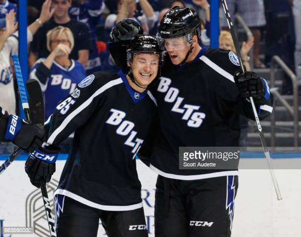 Yanni Gourde of the Tampa Bay Lightning celebrates his goal with teammate Jake Dotchin and against the Montreal Canadiens during third period at...