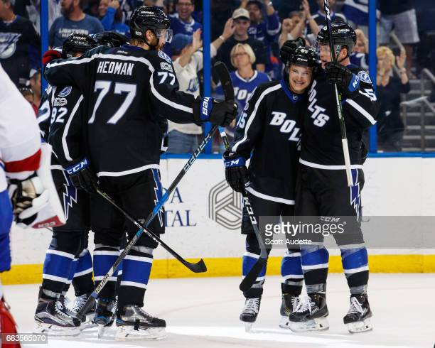 Yanni Gourde of the Tampa Bay Lightning celebrates his goal with teammates Joel Vermin Victor Hedman and Jake Dotchin against the Montreal Canadiens...