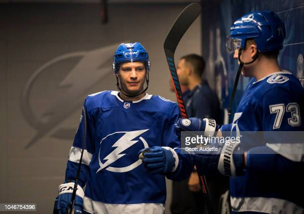 Yanni Gourde of the Tampa Bay Lightning gets ready for pregame warm ups against the Florida Panthers dat Amalie Arena on October 6 2018 in Tampa...