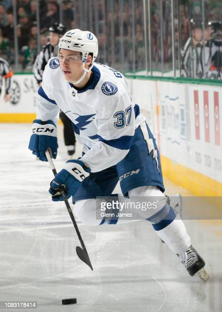 Yanni Gourde of the Tampa Bay Lightning handles the puck against the Dallas Stars at the American Airlines Center on January 15 2019 in Dallas Texas