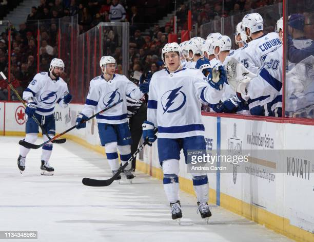 Yanni Gourde of the Tampa Bay Lightning high fives the bench after a first period goal on the Ottawa Senators at Canadian Tire Centre on April 1 2019...