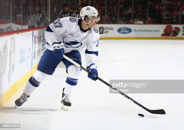 Yanni Gourde of the Tampa Bay Lightning plays the puck against the New Jersey Devils in Game Four of the Eastern Conference First Round during the...