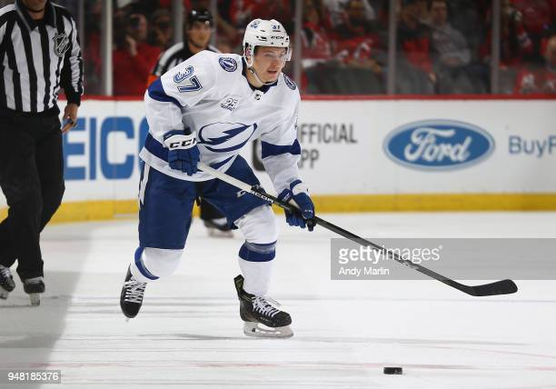 Yanni Gourde of the Tampa Bay Lightning plays the puck in Game Three of the Eastern Conference First Round against the New Jersey Devils during the...