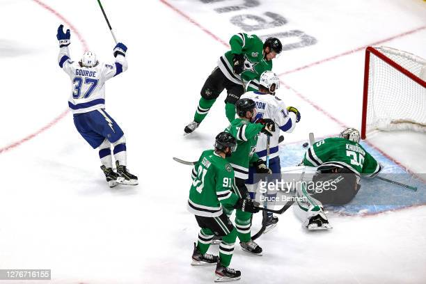 Yanni Gourde of the Tampa Bay Lightning scores a goal past Anton Khudobin of the Dallas Stars during the second period in Game Four of the 2020 NHL...