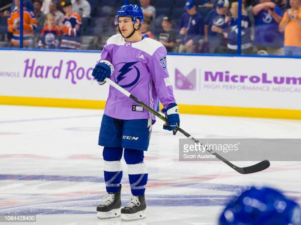 Yanni Gourde of the Tampa Bay Lightning wears a lavender jersey for Hockey Fights Cancer night for the pregame warm ups against the Edmonton Oilers...