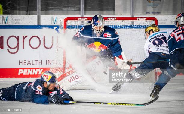 Yannic Seidenberg, Kevin Reich of EHC Red Bull Muenchen and Mark Olver of the Eisbaeren Berlin during the Magenta Sport Cup match between EHC Red...