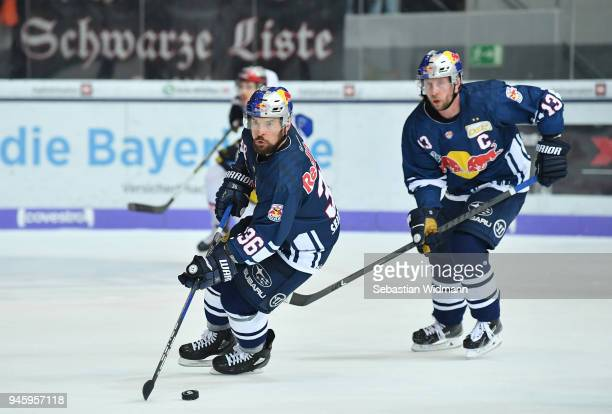 Yannic Seidenberg of EHC Muenchen skates with the puck next to teammate Michael Wolf during the DEL Playoff Final Game 1 between EHC Red Bull...