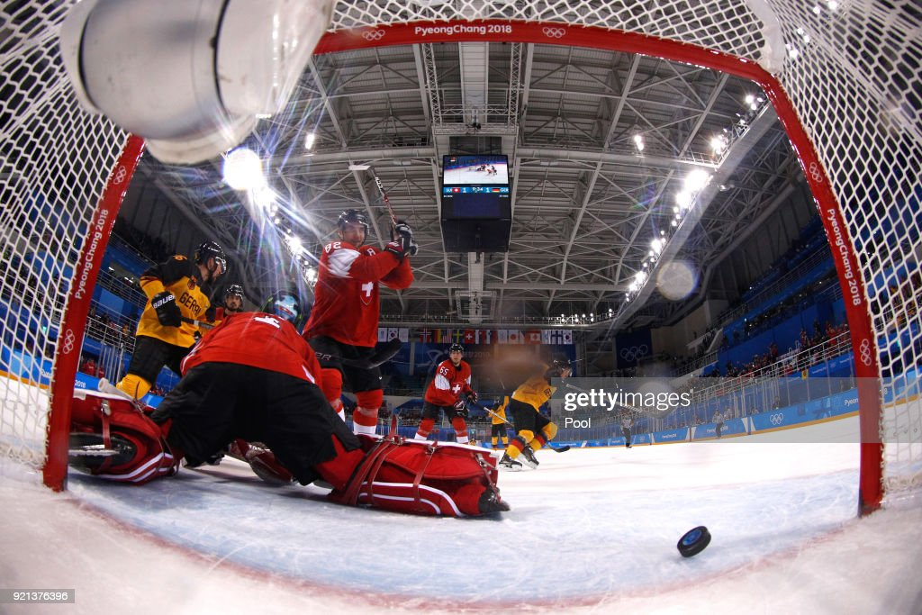 Yannic Seidenberg #36 of Germany celebrates after scoring against Simon Moser #82 and goalie Jonas Hiller #1 of Switzerland in overtime during the Men's Ice Hockey Qualification Playoff game on day eleven of the PyeongChang 2018 Winter Olympic Games at Kwandong Hockey Centre on February 20, 2018 in Gangneung, South Korea. Germany defeated Switzerland 2-1.