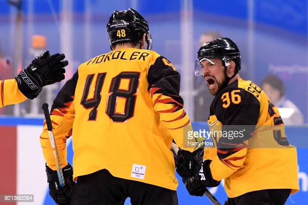 Yannic Seidenberg of Germany celebrates scoring a goal in overtime to defeat Switzerland 21 during the Men's Ice Hockey Qualification Playoff game on...