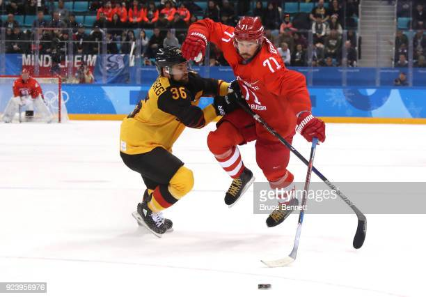 Yannic Seidenberg of Germany competes for the puck with Ilya Kovalchuk of Olympic Athlete from Russia in the second period during the Men's Gold...