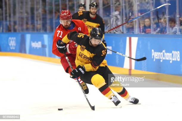 Yannic Seidenberg of Germany controls the puck against Ilya Kovalchuk of Olympic Athlete from Russia in overtime during the Men's Gold Medal Game on...