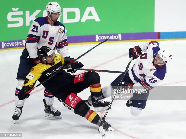 Yannic Seidenberg of Germany is challenged by Johnny Gaudreau of USA during the international friendly game between Germany and USA ahead of the 2019...