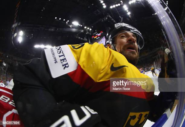 Yannic Seidenberg of Germany is challenged during the 2017 IIHF Ice Hockey World Championship game between Germany and Russia at Lanxess Arena on May...