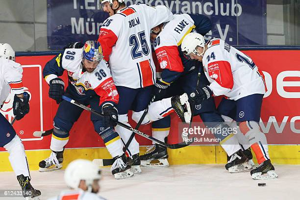 Yannic Seidenberg of Munich, Philip Holm and Joakim Hillding of Vaxjo during the Champions Hockey League Round of 32 match between Red Bull Munich...