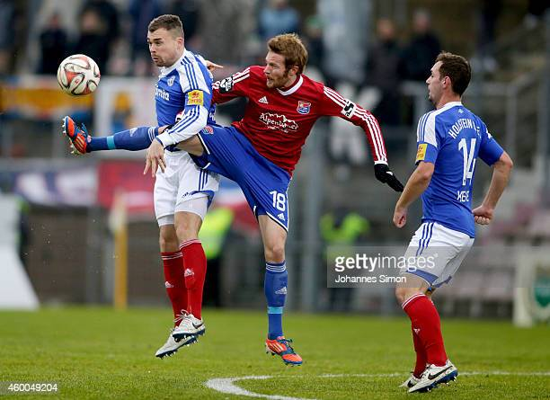 Yannic Thiel of Unterhaching and Marlon Krause and Maik Kegel of Kiel fight for the ball during the Third League match between SpVgg Unterhaching and...